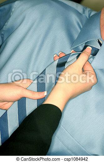 Woman adjusting tie - csp1084942