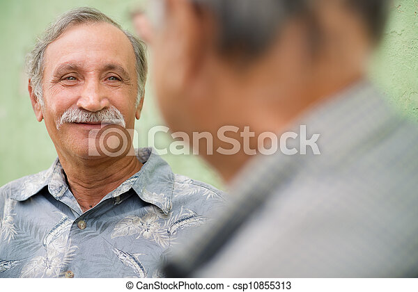 Two senior friends meeting and talking in park - csp10855313