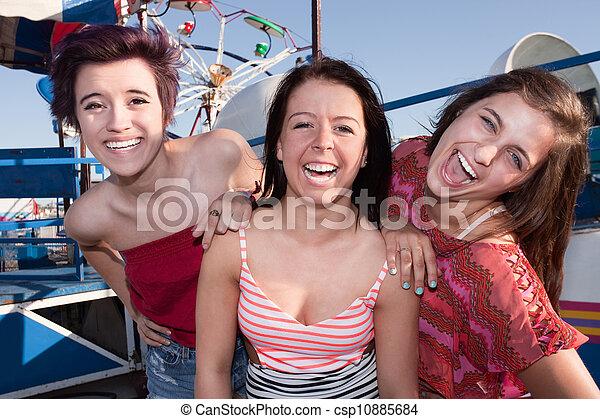 Happy Girls at an Amusement Park - csp10885684