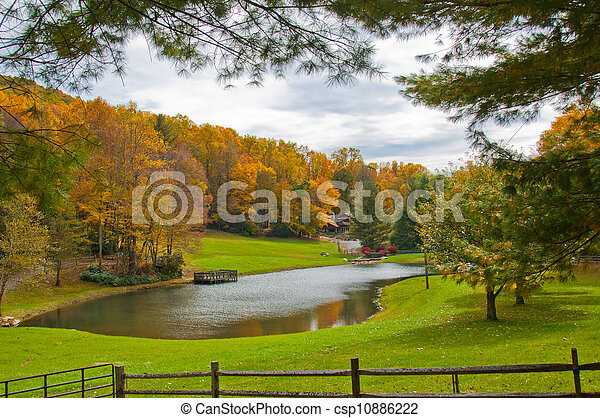 Lake House surrounded by Fall foliage - csp10886222