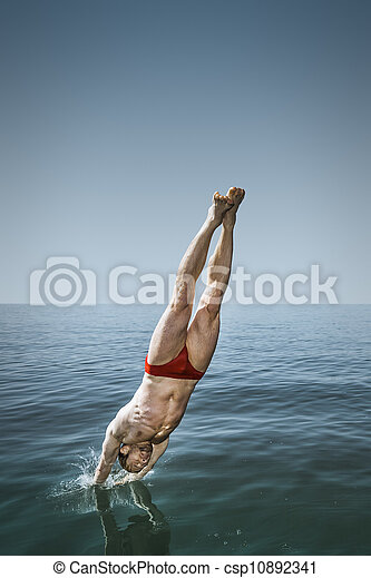 man jumping in the lake - csp10892341