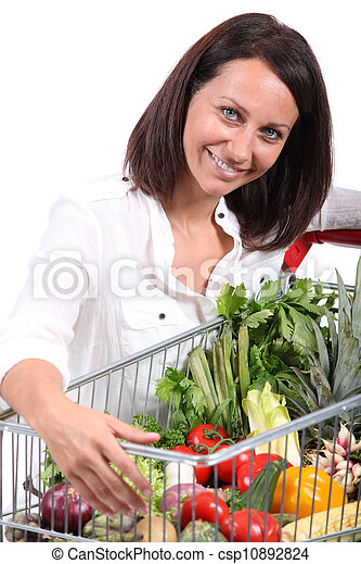 Woman with a trolley full of vegetables - csp10892824