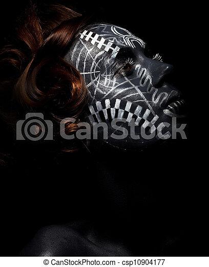Religion. Worship. Black female in ceremonial mask - csp10904177
