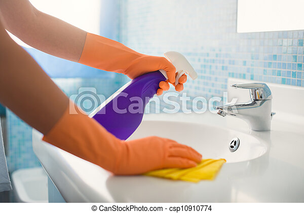 woman doing chores cleaning bathroom at home - csp10910774