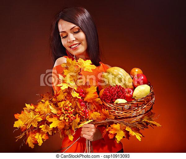 Woman holding autumn basket. - csp10913093