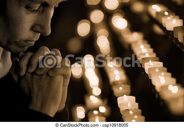 Woman praying in church - csp10918005