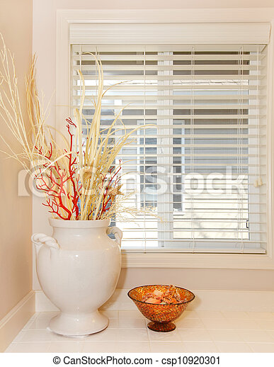 Window with white vase and tiles - bathroom details. - csp10920301