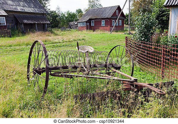 Rake hay in agriculture obsolete model - csp10921344