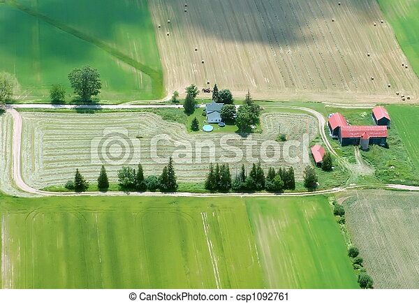 Aerial View of Farming House with red roof - csp1092761