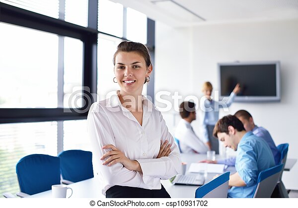 business woman with her staff in background at office - csp10931702