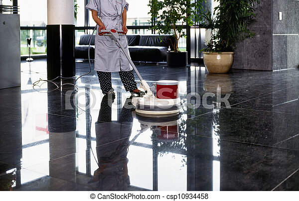 Adult cleaner maid woman with uniform cleaning corridor pass floor - csp10934458