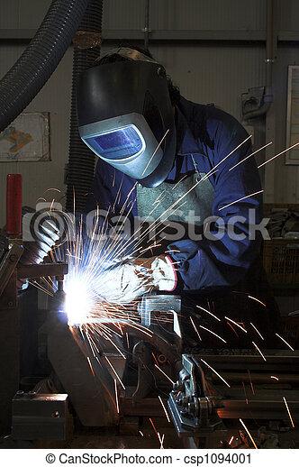 Welding welding a metal part in an industrial environment - csp1094001