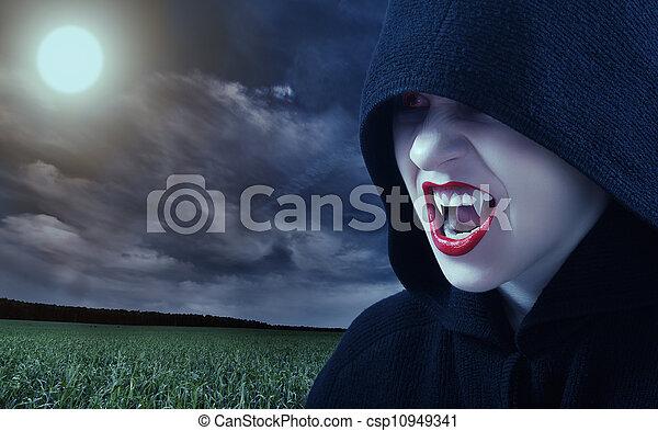 angry female vampire at sunset - csp10949341
