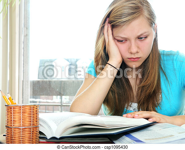 Teenage girl studying with textbooks - csp1095430