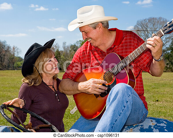 Singing Cowboy & Wife Flirting - csp1096131