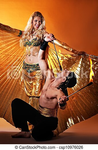 Arabic dancer with fire eater