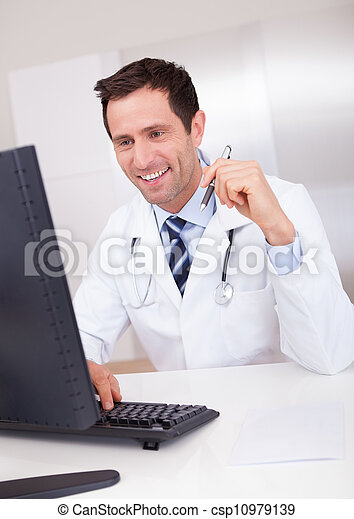 Smiling Medical Doctor With Stethoscope - csp10979139