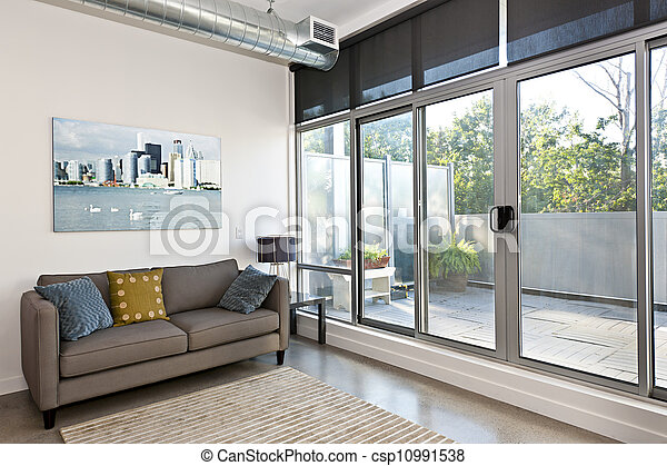 Modern living room and balcony - csp10991538