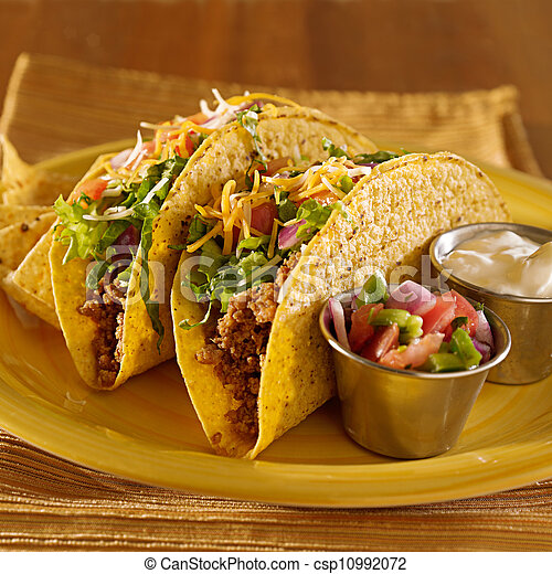 Tacos on a platter with tortillas - mexican food - csp10992072