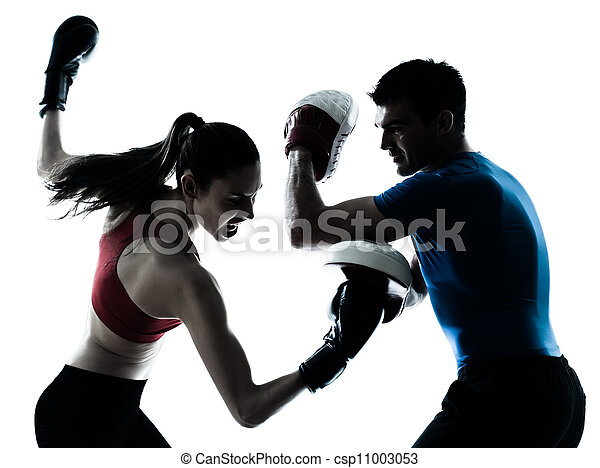 coach man woman exercising boxe - csp11003053