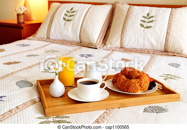 Breakfast on a bed in a hotel room - csp1100565