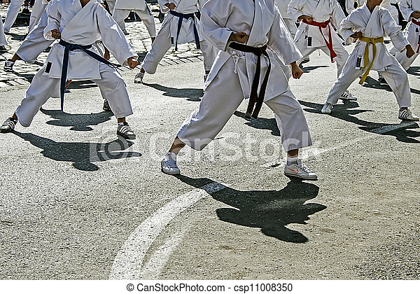 Karate demonstration, made ??by young people on a street