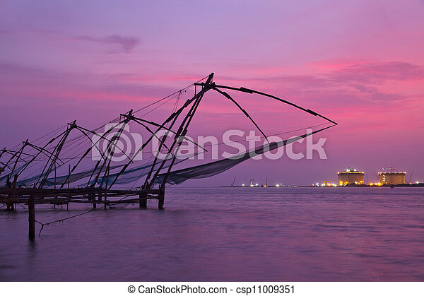Chinese fishnets on sunset. Kochi, Kerala, India - csp11009351