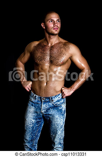 Portrait of a handsome muscular guy with nude torso