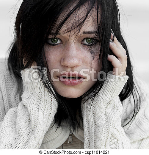 Sad girl in sweater.