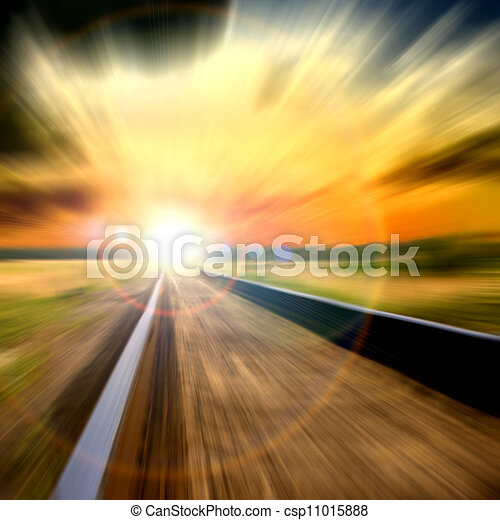 Speed blurred railroad into the sunset  - csp11015888