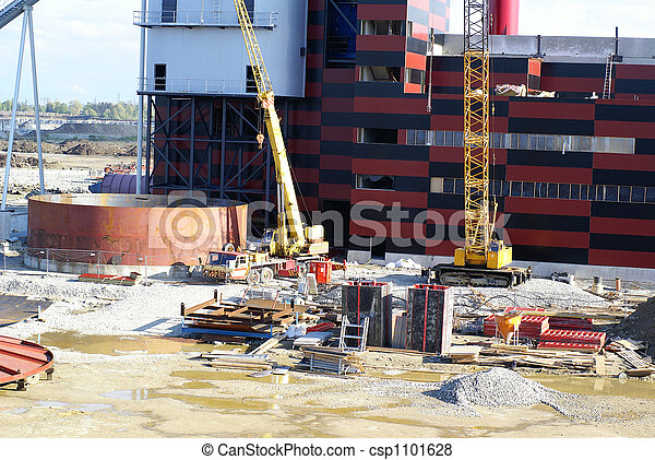 cranes and chinmey on construction of industrial factory  - csp1101628