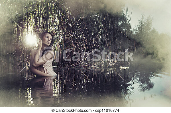 Beautifull woman watching sunrising - csp11016774