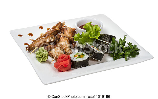 Stock Photo - Buffalo chicken wings on plate with sushi - stock image ...