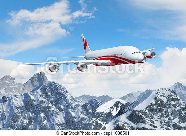 White passenger plane above the mountains - csp11038501