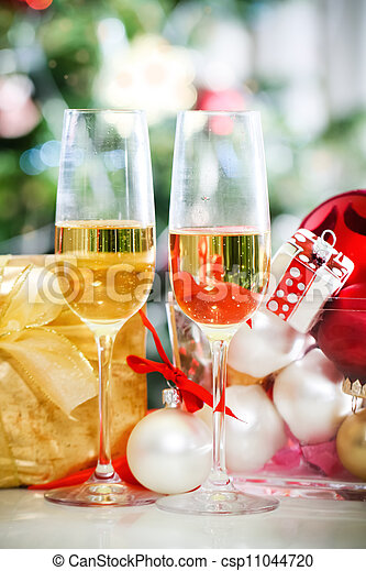 Glasses of champagne and Christmas decorations