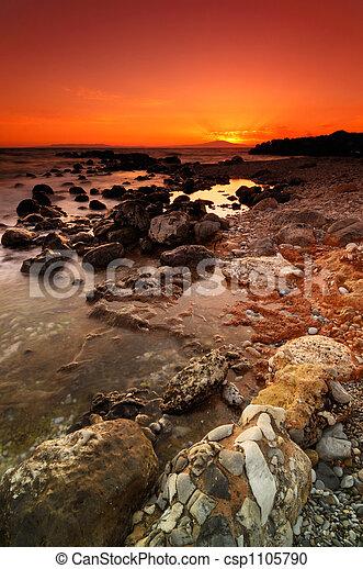 Rocky seascape sunset - csp1105790