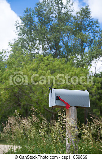 Rural mailbox on an old wooden  - csp11059869