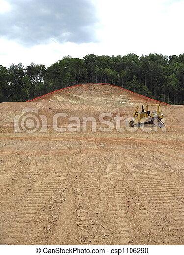 bulldozer with scraped earth - csp1106290