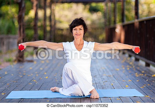 middle aged woman workout  - csp11070352