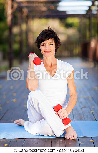 middle aged woman exercise  - csp11070458