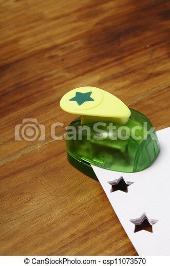 Green punching machine for paper scrapbooking - csp11073570