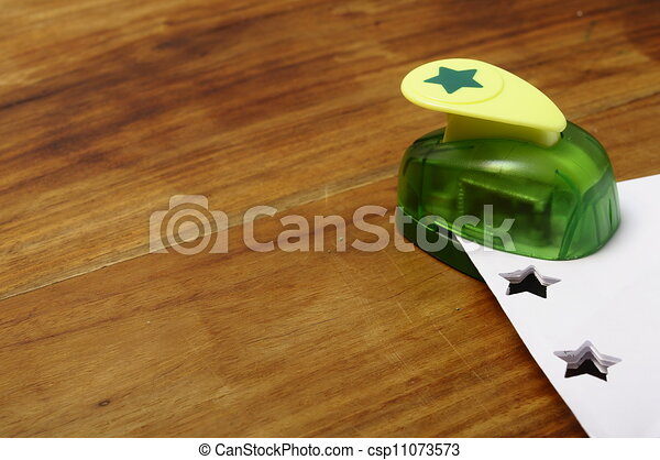 Green punching machine for paper scrapbooking - csp11073573