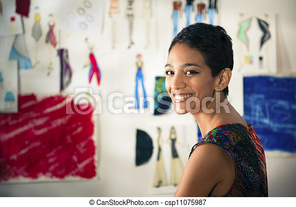 Confident entrepreneur, portrait of happy hispanic young woman working as fashion designer and dressmaker in atelier - csp11075987