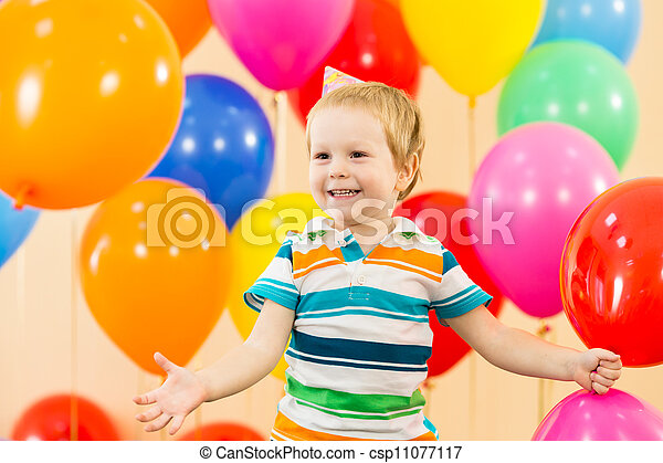 joyful kid boy on birthday party - csp11077117