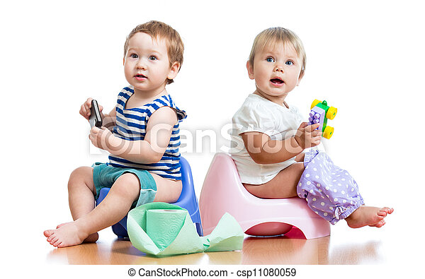 babies toddlers sitting on chamber pot and playing with toys - csp11080059