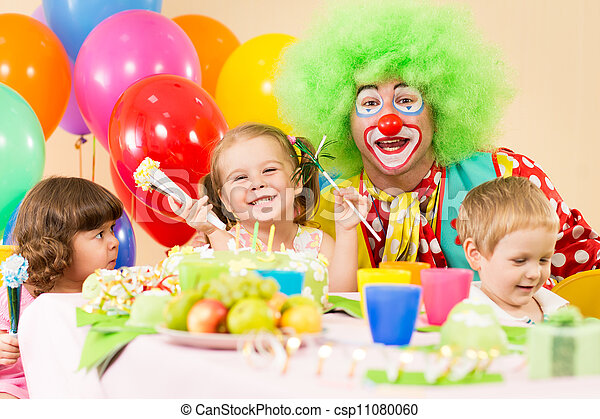 kids celebrating birthday party with clown - csp11080060