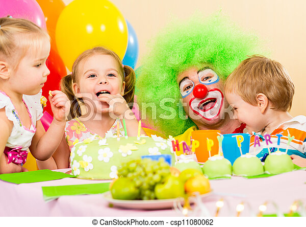 kids celebrating birthday party with clown - csp11080062