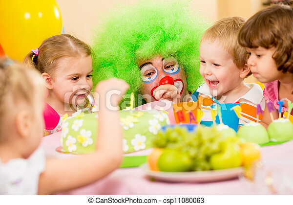 kids celebrating birthday party with clown - csp11080063
