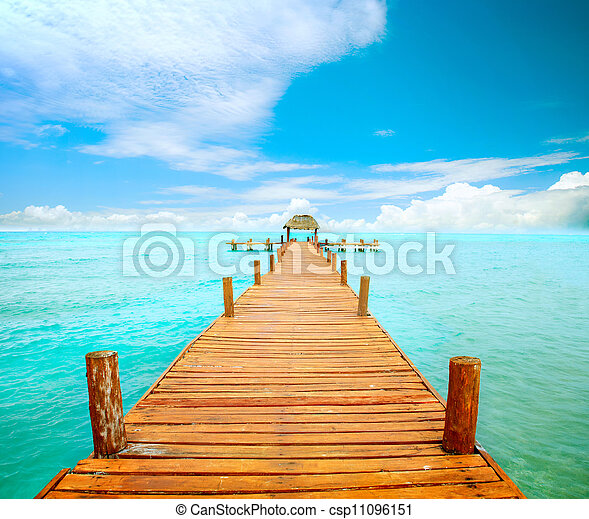 Vacations And Tourism Concept. Jetty on Isla Mujeres, Mexico  - csp11096151