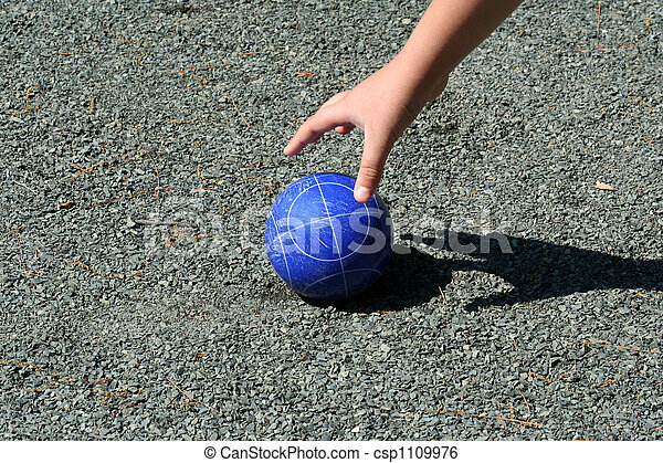 Hand reaching for a bocce ball - csp1109976